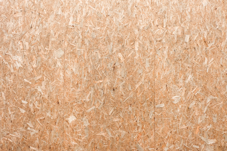 OSB plywood or oriented strand board, wood wall background texture