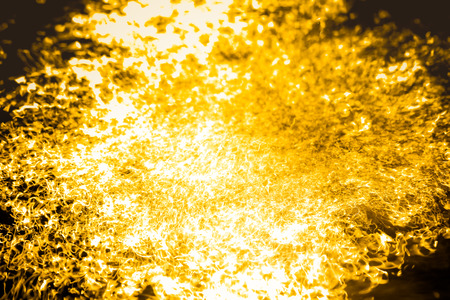Abstract background liquid gold flowing quickly.