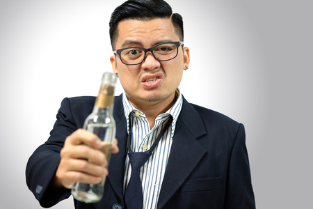 beer and necktie: Asian Man drunk after work isolated on white background