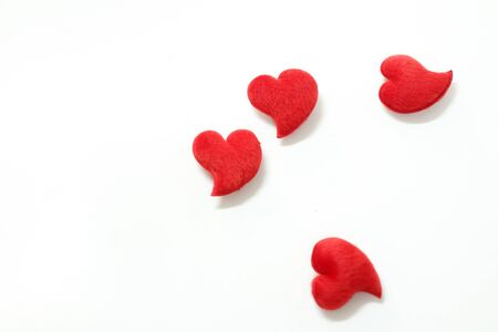 The four red hearts for Valentines Day decorations. On a white background
