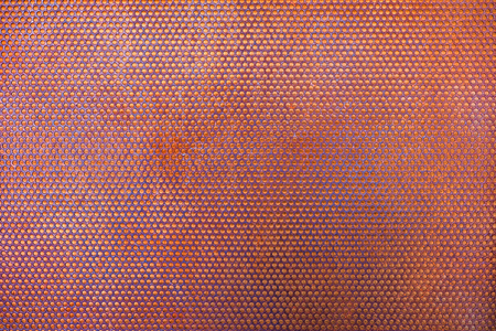 Steel grating rusty with circular holes, background texture Stock Photo