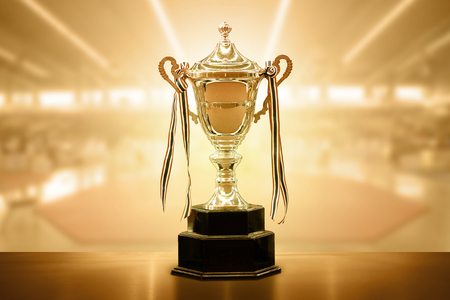 Trophy competition Put on the table on the abstract background Standard-Bild