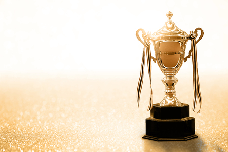 Gold Trophy competition on the abstract glitter background with copy space Reklamní fotografie - 78147450