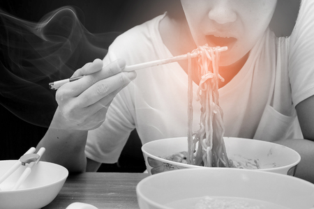 Asian women are eating hot noodles with spicy flavors.