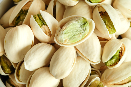 Roasted salted Pistachios are dried nuts close up Standard-Bild