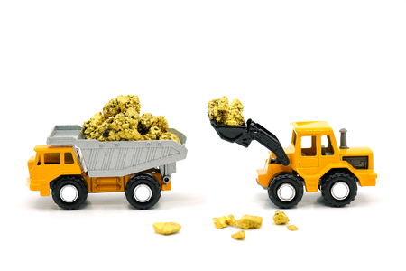 Dump truck and bulldozer Dealing with gold ore mine on white background Stock Photo