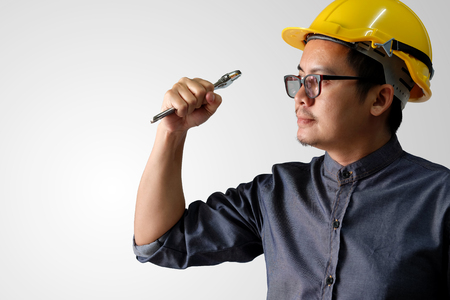 A young engineer is actively acting ready to work on a white background.