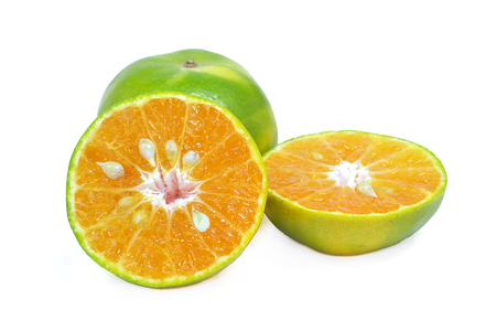 Tangerine or Mandarin Orange half cut on a white background with clipping path