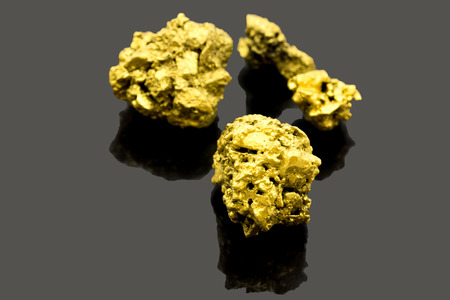 The pure gold ore found in the mine on black background Stock Photo
