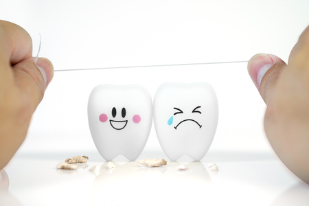 Hand of man holding Dental floss with Teeth smile and crying emotion ,Concept Dental care cleaning bacterial plaque