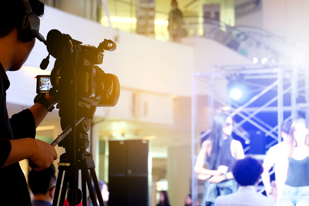 Photographer video recording activity within the event Stock Photo - 91876870