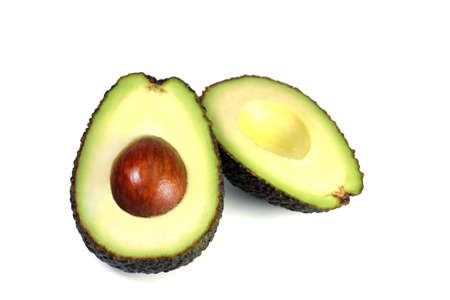 Half slice Premium Avocado New Zealand isolated on white background, with clipping path Stock Photo