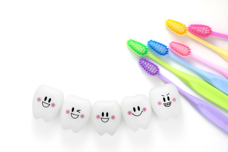 Toys teeth dental in a smiling mood with tooth brush colorful Foto de archivo