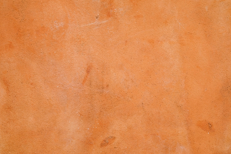 Natural red clay earth wall background texture.