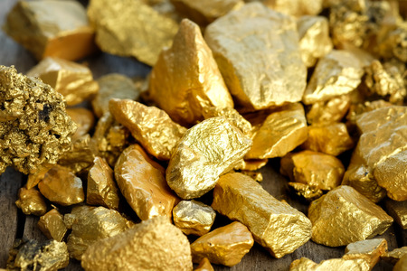 The pure gold ore found in the mine on a wooden floor