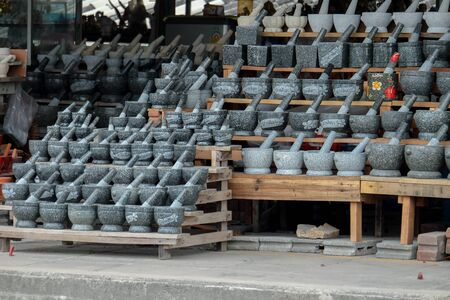 Chonburi, Thailand - November 5, 2017: A storehouse filled with mortar stones made of granite. The famous product of Ang Sila Chonburi. Редакционное