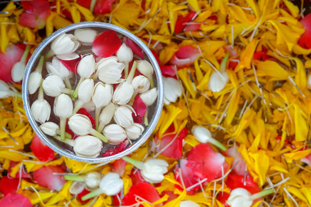 Jasmine roses and marigold petals  in silver bowl ,Songkran festival in Thailand