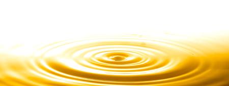 Liquid gold drop and ripple ,abstract background Standard-Bild - 103383731