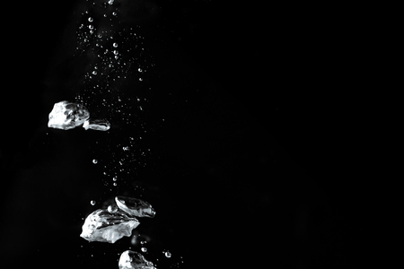 Pouring water has an abstract bubble on a black background. Reklamní fotografie