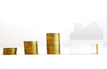 Gold coin stacked 3 step or graphs with wooden home on a white background, Business investment concept And saving money for growth