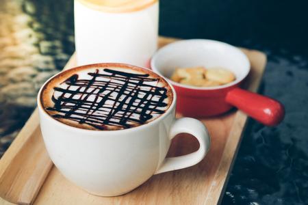 Mocha hot coffee on the wood plate