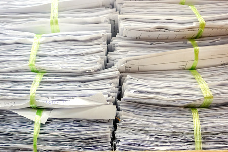 Background texture Lots of paperwork Tied and stacked.