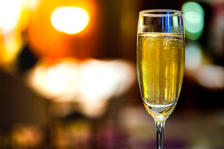 Sparkling Wine Glass or champagne on Marble Table On the background blurred
