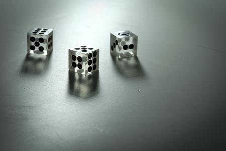 3 dice on a white background in the dark, Reklamní fotografie
