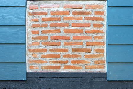 Texture Red brick wall and wooden wall artificial blue Banco de Imagens