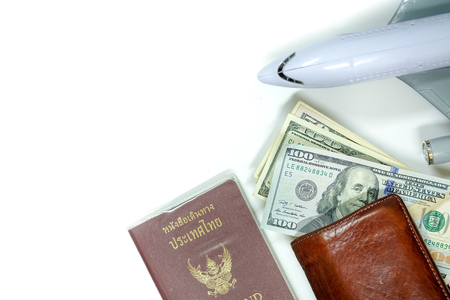 Banknote wallet, pens, passport and airplane on a white, travel accessories holiday concept Фото со стока