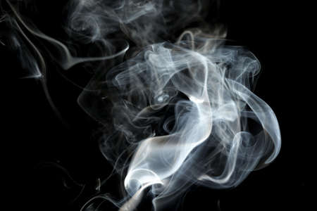 Smoke or steam on a black background, Abstract