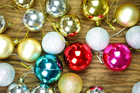 Christmas Ball colorful decorations on a wood background