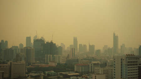 The landscape of Bangkok where the weather is covered with small dust, PM2.5 microns, has an air quality index (Aqi) that exceeds pollution standards. Stock Photo