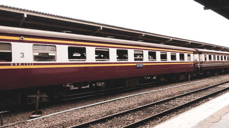 Thai trains that have been used for a long time, stop waiting to pick up passengers or stop at the station.
