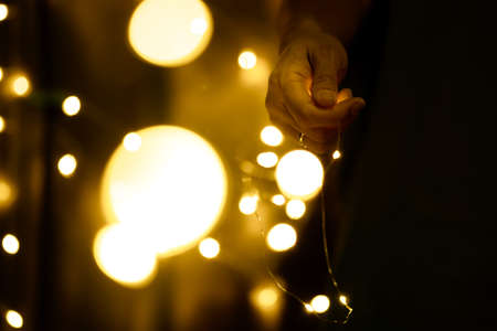 Christmas and Happy New Year decorations lighting in the hands of young women