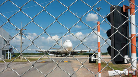 The metal fence prevented unauthorized persons from entering the airport area.