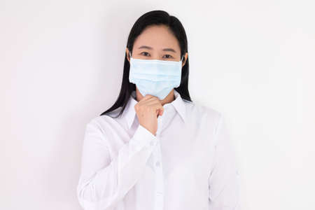 Asian woman in white dress Campaign and demonstrate wearing the right mask on a white background Stock fotó