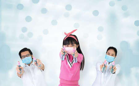 Asian families are strong in defeating the virus by wearing a mask and carrying alcohol bottles for washing hands, cleaning or spraying infected items. Covid-19