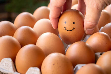 Eggs in the hands smile with a good mood, the concept is happy to eat.