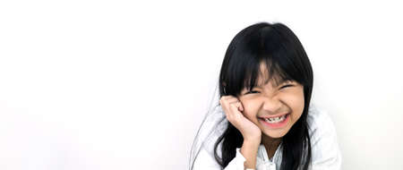 Asian child girl in a white shirt with smiling face on a white background, Happy time
