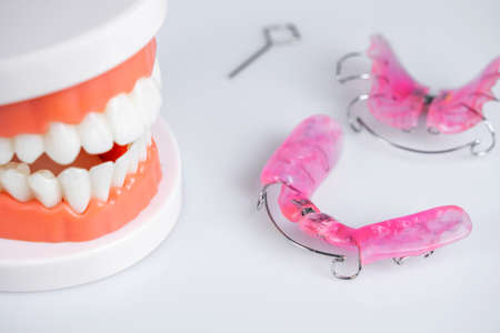 Dental extension device Removable braces for children with distorted teeth and Molded teeth on white background
