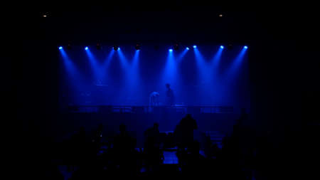 Stage blue lighting beams spotlight of events show or concerts