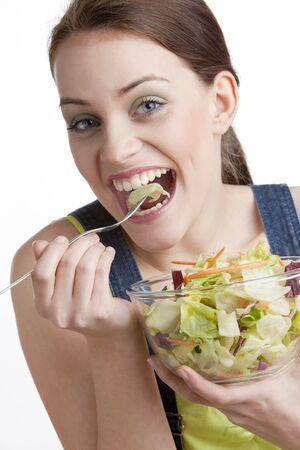 portrait of woman eating salad Stock Photo - 5056616