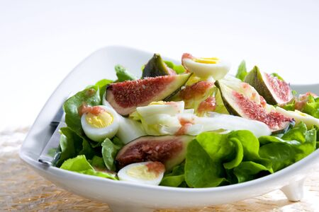 salad with figs and quail eggs photo