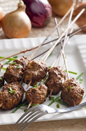 onions: minced meat balls on skewer