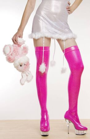 extravagancy: extravagant pink boots and hand holding a rabbit toy