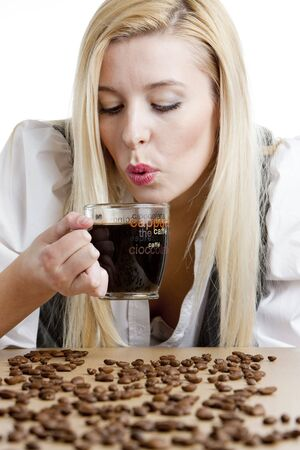 portrait of businesswoman with a cup of coffee photo