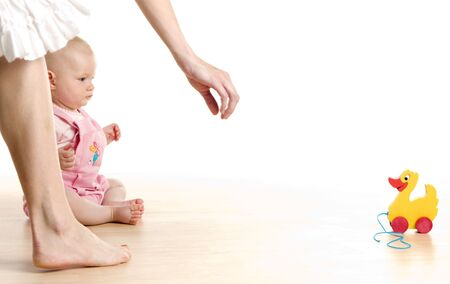 women children: baby girl with a toy sitting on the floor