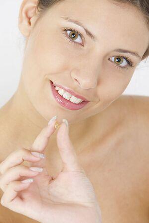 portrait of woman with vitamin E Stock Photo - 5338163