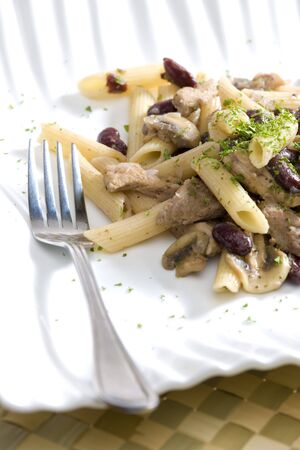 champignons: penne with pork pieces and champignons